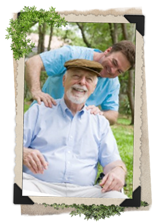 A youg, brunette caregiver helps an older man with a brown hat.